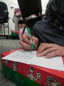Operation Christmas- Student writes a letter of encouragement for their box