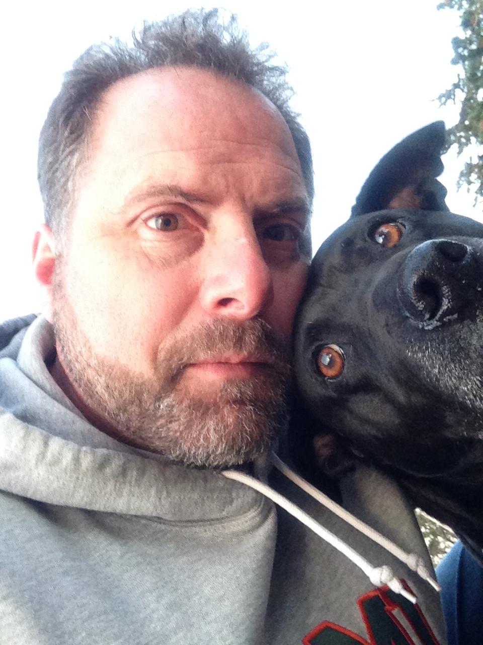 AP history teacher Bill Schrier takes a selfie with his dog, Roxi, at Carmel - Schrier1