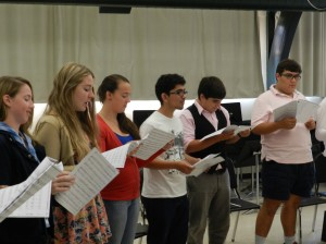The concert choir students tune up their performance skills for show time.