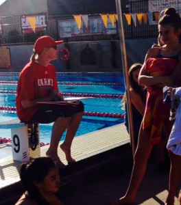Coach Stachelek gives her swimmers a pre-practice pep talk and discusses the goals for the new season.