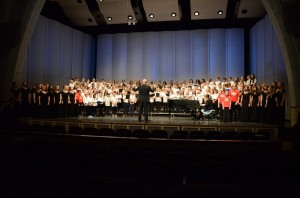 The combined school choirs perform the finale together.
