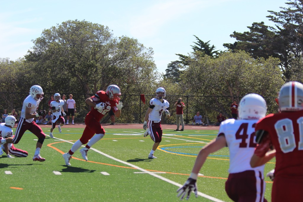 Senior receiver John Stivers sprints through the Sacred Heart defense on Sept. 26.