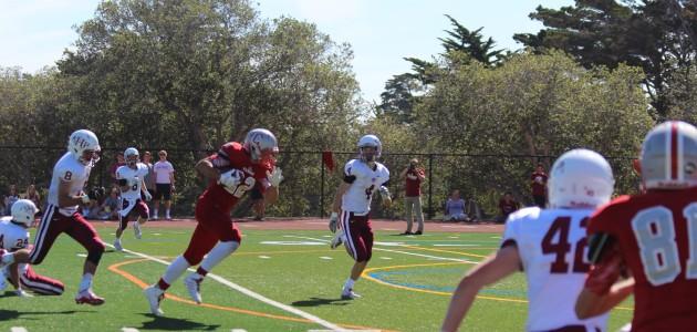 Senior receiver John Stivers sprints through the Sacred Heart defense on Sept. 26.