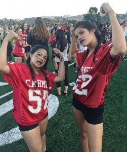 Naomi Takaoka (right) with fellow senior Giorgia Ola after winning the 2015 Powderpuff game against the juniors.